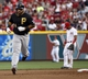 Jul 11, 2014; Cincinnati, OH, USA; Pittsburgh Pirates third baseman Pedro Alvarez (24) rounds the bases after hitting a three-run home run off Cincinnati Reds starting pitcher Mat Latos (not pictured) in the fourth inning at Great American Ball Park. Mandatory Credit: David Kohl-USA TODAY Sports