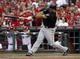 Jul 11, 2014; Cincinnati, OH, USA; Pittsburgh Pirates third baseman Pedro Alvarez hits a three-run home run off Cincinnati Reds starting pitcher Mat Latos (not pictured) in the fourth inning at Great American Ball Park. Mandatory Credit: David Kohl-USA TODAY Sports