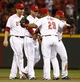 Jul 11, 2014; Cincinnati, OH, USA; Cincinnati Reds catcher Brayan Pena (29) is congratulated by third baseman Todd Frazier (left) and shortstop Zack Cozart (center) and second baseman Ramon Santiago (right) after the Reds defeated the Pittsburgh Pirates 6-5 at Great American Ball Park. Mandatory Credit: David Kohl-USA TODAY Sports