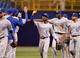 Jul 7, 2014; St. Petersburg, FL, USA; Kansas City Royals center fielder Jarrod Dyson (1) and teammates high five against the Tampa Bay Rays at Tropicana Field. Kansas City Royals defeated the Tampa Bay Rays 6-0.  Mandatory Credit: Kim Klement-USA TODAY Sports