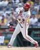 Jul 5, 2014; Pittsburgh, PA, USA; Philadelphia Phillies shortstop Jimmy Rollins (11) at bat against the Pittsburgh Pirates during the fifth inning at PNC Park. The Pirates won 3-2. Mandatory Credit: Charles LeClaire-USA TODAY Sports