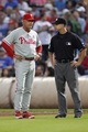 Jul 18, 2014; Atlanta, GA, USA; Philadelphia Phillies manager Ryne Sandberg (23) talks to umpire Will Little (93) in the second inning  against the Atlanta Braves at Turner Field. Mandatory Credit: Brett Davis-USA TODAY Sports