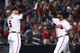 Jul 18, 2014; Atlanta, GA, USA; Atlanta Braves first baseman Freddie Freeman (5) and left fielder Justin Upton (8) celebrate a victory against the Philadelphia Phillies in the ninth inning at Turner Field. The Braves defeated the Phillies 6-4.  Mandatory Credit: Brett Davis-USA TODAY Sports