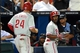 Jul 19, 2014; Atlanta, GA, USA; Philadelphia Phillies shortstop Jimmy Rollins (11) reacts with left fielder Grady Sizemore (24) after hitting a home run against the Atlanta Braves during the seventh inning at Turner Field. Mandatory Credit: Dale Zanine-USA TODAY Sports