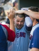 Jul 22, 2014; Minneapolis, MN, USA; Cleveland Indians designated hitter Nick Swisher (33) gets congratulated after he scores in the second inning against the Minnesota Twins at Target Field. Mandatory Credit: Brad Rempel-USA TODAY Sports