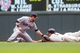 Jul 23, 2014; Minneapolis, MN, USA; Minnesota Twins left fielder Sam Fuld is tagged out at second in the first inning by Cleveland Indians second baseman Jason Kipnis (22) at Target Field. Mandatory Credit: Brad Rempel-USA TODAY Sports