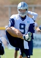 Jul 24, 2014; Oxnard, CA, USA; Dallas Cowboys quarterback Tony Romo (9) stretches on the first day of their ninth year of training camp in Oxnard at the River Ridge Playing Fields.  Mandatory Credit: Jayne Kamin-Oncea-USA TODAY Sports