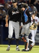Jul 24, 2014; Atlanta, GA, USA; Miami Marlins relief pitcher Steve Cishek (31) celebrates their 3-2 win with Miami Marlins catcher Jarrod Saltalamacchia (39) in their game against the Miami Marlins at Turner Field. Marlins won 3-2. Mandatory Credit: Jason Getz-USA TODAY Sports