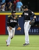Jul 24, 2014; Atlanta, GA, USA; Miami Marlins center fielder Marcell Ozuna (13, left) and left fielder Christian Yelich (21) celebrate their 3-2 win over the Atlanta Braves at Turner Field. Mandatory Credit: Jason Getz-USA TODAY Sports