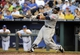 Jul 25, 2014; Kansas City, MO, USA; Cleveland Indians first baseman Carlos Santana (41) hits a home run against the Kansas City Royals in the fourth inning at Kauffman Stadium. Mandatory Credit: John Rieger-USA TODAY Sports