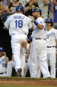 Jul 25, 2014; Kansas City, MO, USA; Kansas City Royals right fielder Raul Ibanez (18) is congratulated by left fielder Alex Gordon (4) after scoring in the fourth inning against the Cleveland Indians at Kauffman Stadium. Mandatory Credit: John Rieger-USA TODAY Sports