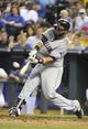 Jul 25, 2014; Kansas City, MO, USA; Cleveland Indians first baseman Carlos Santana (41) hits a 2 run home run against the Kansas City Royals in the sixth inning at Kauffman Stadium. Mandatory Credit: John Rieger-USA TODAY Sports