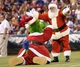 Jul 25, 2014; Philadelphia, PA, USA; The Phillie Phanatic has some fun with Santa Claus during Christmas in July at the ball park during a game against the Arizona Diamondbacks at at Citizens Bank Park. Mandatory Credit: Bill Streicher-USA TODAY Sports