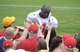 Jul 26, 2014; St. Joseph, MO, USA; Kansas City Chiefs linebacker Tamba Hali (91) signs autographs after practice during training camp at Missouri Western State University. Mandatory Credit: John Rieger-USA TODAY Sports