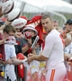 Jul 26, 2014; St. Joseph, MO, USA; Kansas City Chiefs quarterback Alex Smith (11) signs autographs after practice during training camp at Missouri Western State University. Mandatory Credit: John Rieger-USA TODAY Sports