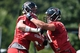 Jul 26, 2014; Atlanta, GA, USA; Atlanta Falcons offensive tackle Jake Matthews (70) (right) works on a blocking drill with tackle Ryan Schraeder (73) on the field during training camp at Falcons Training Complex. Mandatory Credit: Dale Zanine-USA TODAY Sports