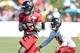Jul 26, 2014; Atlanta, GA, USA; Atlanta Falcons wide receiver Geraldo Boldewijn (15) catches a pass in front of cornerback Jordan Mabin (24) on the field during training camp at Falcons Training Complex. Mandatory Credit: Dale Zanine-USA TODAY Sports