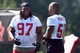Jul 26, 2014; Atlanta, GA, USA; Atlanta Falcons defensive tackle Peria Jerry (97) shares a laugh with defensive end Osi Umenyiora (50) on the field during training camp at Falcons Training Complex. Mandatory Credit: Dale Zanine-USA TODAY Sports