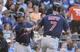 Jul 26, 2014; Kansas City, MO, USA; Cleveland Indians right fielder David Murphy (7) is congratulated by second baseman Jose Ramirez (11) after scoring against the Kansas City Royals in the second inning at Kauffman Stadium. Mandatory Credit: John Rieger-USA TODAY Sports