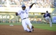 Jul 26, 2014; Kansas City, MO, USA; Kansas City Royals center fielder Lorenzo Cain (6) advances to third base in the fourth inning against the Cleveland Indians at Kauffman Stadium. Mandatory Credit: John Rieger-USA TODAY Sports
