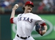 Jul 27, 2014; Arlington, TX, USA; Texas Rangers starting pitcher Miles Mikolas (36) delivers a pitch to the Oakland Athletics during the first inning of a baseball game at Globe Life Park in Arlington. Mandatory Credit: Jim Cowsert-USA TODAY Sports