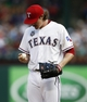 Jul 27, 2014; Arlington, TX, USA; Texas Rangers starting pitcher Miles Mikolas (36) looks down a the ball between throws to the Oakland Athletics during the second inning of a baseball game at Globe Life Park in Arlington. Mandatory Credit: Jim Cowsert-USA TODAY Sports
