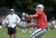 Jul 28, 2014; Napa, CA, USA; Oakland Raiders quarterback Matt Schaub (8) throws a pass as coach Dennis Allen watches at training camp at Napa Valley Marriott. Mandatory Credit: Kirby Lee-USA TODAY Sports