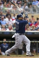 Jul 19, 2014; Minneapolis, MN, USA; Tampa Bay Rays catcher Jose Molina (28) hits a RBI single in the second inning against the Minnesota Twins at Target Field. Mandatory Credit: Jesse Johnson-USA TODAY Sports
