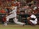 Jul 28, 2014; Cincinnati, OH, USA; Arizona Diamondbacks shortstop Nick Ahmed (13) hits an RBI-single in the 15th inning at Great American Ball Park. The Diamondbacks won 2-1 in 15 innings. Mandatory Credit: David Kohl-USA TODAY Sports