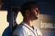 Jul 24, 2014; Atlanta, GA, USA; The afternoon light hits Atlanta Braves second baseman Tommy La Stella (7) as he watches from the dugout during their game against the Miami Marlins at Turner Field. Marlins won 3-2. Mandatory Credit: Jason Getz-USA TODAY Sports
