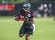 Jul 26, 2014; Houston, TX, USA; Houston Texans wide receiver Lacoltan Bester (12) catches a pass during training camp at Houston Methodist Training Center. Mandatory Credit: Troy Taormina-USA TODAY Sports