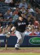 Jul 24, 2014; Atlanta, GA, USA; Miami Marlins catcher Jarrod Saltalamacchia (39) hits an RBI single scoring Miami Marlins center fielder Marcell Ozuna (not pictured) in the ninth inning of their game against the Miami Marlins at Turner Field. Marlins won 3-2. Mandatory Credit: Jason Getz-USA TODAY Sports