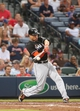 Jul 24, 2014; Atlanta, GA, USA; Miami Marlins right fielder Giancarlo Stanton (27) hits a single in the sixth inning of their game against the Atlanta Braves at Turner Field. Marlins won 3-2. Mandatory Credit: Jason Getz-USA TODAY Sports