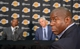 Jul 29, 2014; El Segundo, CA, USA; Magic Johnson (right) listens at a press conference with Byron Scott (left) and Los Angeles Lakers general manager Mitch Kupchak (center) at Toyota Sports Center. Mandatory Credit: Kirby Lee-USA TODAY Sports