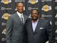 Jul 29, 2014; El Segundo, CA, USA; Byron Scott (left) poses with sports agent Emanuel Hudson at a press conference to announce his hiring as Los Angeles Lakers coach at Toyota Sports Center. Mandatory Credit: Kirby Lee-USA TODAY Sports