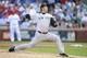 Jul 30, 2014; Arlington, TX, USA; New York Yankees starting pitcher Hiroki Kuroda (18) throws a pitch in the first inning against the Texas Rangers at Globe Life Park in Arlington. Mandatory Credit: Tim Heitman-USA TODAY Sports