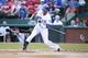 Jul 30, 2014; Arlington, TX, USA; Texas Rangers center fielder Leonys Martin (2) hits a single in the first inning against the New York Yankees at Globe Life Park in Arlington. Mandatory Credit: Tim Heitman-USA TODAY Sports