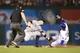 Jul 30, 2014; Arlington, TX, USA;Texas Rangers center fielder Leonys Martin (2) steals second base and avoids the tag of New York Yankees second baseman Brendan Ryan (17) in the eighth inning  at Globe Life Park in Arlington.  Texas beat New York 3-2. Mandatory Credit: Tim Heitman-USA TODAY Sports