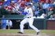 Jul 30, 2014; Arlington, TX, USA; Texas Rangers left fielder Jim Adduci (35) singles in the first inning against the New York Yankees at Globe Life Park in Arlington.  Texas beat New York 3-2. Mandatory Credit: Tim Heitman-USA TODAY Sports