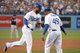 Jul 30, 2014; Los Angeles, CA, USA; Los Angeles Dodgers right fielder Matt Kemp (27) is congratulated by third base coach Lorenzo Bundy (49) after hitting a solo home run in the second inning against the Atlanta Braves at Dodger Stadium. Mandatory Credit: Kirby Lee-USA TODAY Sports