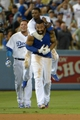 Jul 30, 2014; Los Angeles, CA, USA; Los Angeles Dodgers right fielder Matt Kemp (27) celebrates with teammates Dee Gordon (9) and shortstop Miguel Rojas (72) a hitting a walk-off single in the 10th inning against the Atlanta Braves at Dodger Stadium. The Dodgers defeated the Braves 2-1 in 10 innings. Mandatory Credit: Kirby Lee-USA TODAY Sports