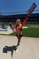 Aug 2, 2014; Denver, CO, USA; Denver Broncos cheerleader gives away a calendars following a scrimmage at Sports Authority Field. Mandatory Credit: Ron Chenoy-USA TODAY Sports