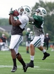 Aug 4, 2014; Cortland, NY, USA; New York Jets wide receiver Quincy Enunwa (left) makes a catch in front of defensive back Rontez Miles (right) during training camp at SUNY Cortland. Mandatory Credit: Rich Barnes-USA TODAY Sports