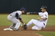August 5, 2014; Oakland, CA, USA; Tampa Bay Rays second baseman Cole Figueroa (35, left) tags out Oakland Athletics right fielder Josh Reddick (16, right) on a steal attempt during the second inning at O.co Coliseum. Mandatory Credit: Kyle Terada-USA TODAY Sports