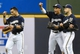 Aug 5, 2014; Milwaukee, WI, USA; Milwaukee Brewers right fielder Gerardo Parra (28), center fielder Carlos Gomez (27), and right fielder Ryan Braun (8) reacts after umpire reversed a call ending the game defeating the San Francisco Giants 4-3 at Miller Park. Mandatory Credit: Benny Sieu-USA TODAY Sports
