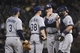 August 5, 2014; Oakland, CA, USA; Tampa Bay Rays pitching coach Jim Hickey (48, second from right) talks to relief pitcher Jeff Beliveau (38) against the Oakland Athletics during the sixth inning at O.co Coliseum. Mandatory Credit: Kyle Terada-USA TODAY Sports