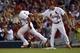 Aug 7, 2014; St. Louis, MO, USA;  St. Louis Cardinals first base coach Chris Maloney (77) congratulates second baseman Kolten Wong (16) after hitting a home run against the Boston Red Sox at Busch Stadium. Mandatory Credit: Jasen Vinlove-USA TODAY Sports