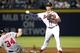 Aug 8, 2014; Atlanta, GA, USA; Atlanta Braves second baseman Tommy La Stella (7) turns a double play over Washington Nationals right fielder Bryce Harper (34) in the fifth inning at Turner Field. Mandatory Credit: Brett Davis-USA TODAY Sports