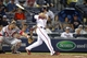 Aug 8, 2014; Atlanta, GA, USA; Atlanta Braves second baseman Tommy La Stella (7) hits his first career home run against the Washington Nationals in the fifth inning at Turner Field. Mandatory Credit: Brett Davis-USA TODAY Sports