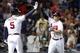 Aug 8, 2014; Atlanta, GA, USA; Atlanta Braves first baseman Freddie Freeman (5) congratulates second baseman Tommy La Stella (7) after a home run against the Washington Nationals in the fifth inning at Turner Field. Mandatory Credit: Brett Davis-USA TODAY Sports